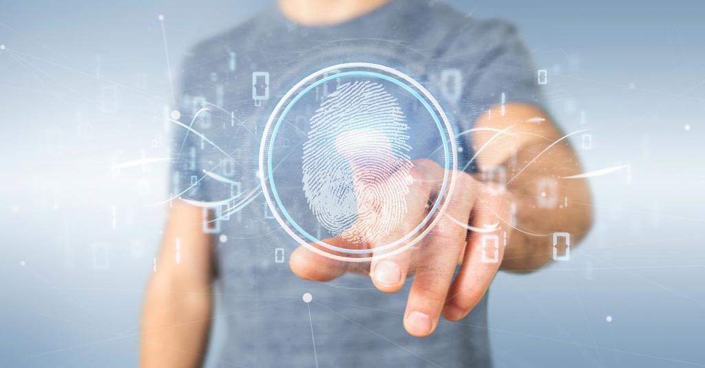 Homem com dedo na tela. Tela com vários ícones tecnológicos e centralizado um ícone de impressão digital.